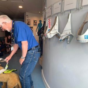 one of our wonderful guide dog volunteers demonstrating the mechanics of a guide dog harness