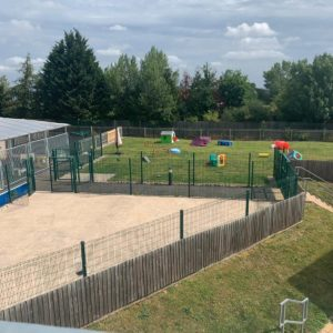 view of the outdoor grassy play area at guide dogs uk national breeding centre warwickshire
