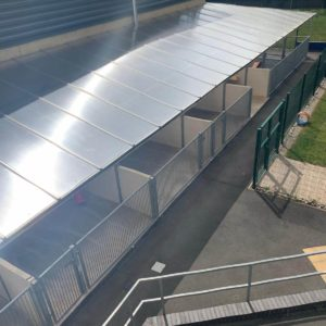 view of the puppy kennel outdoor runs at guide dogs uk national breeding centre warwickshire